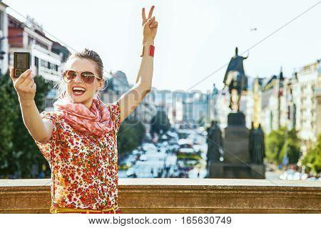 Tourist Woman With Digital Camera Taking Selfie In Prague