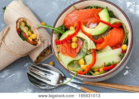 Salad with salmon and chickpeas with wraps for lunch. Love for a healthy food concept