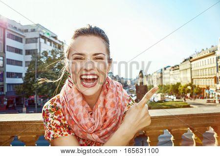 Woman On Vaclavske Namesti In Prague Pointing On Something