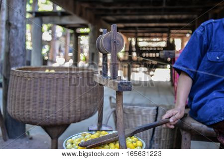 Woman make the silk yarn from cocoons