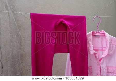 pink legging and pink shirt on clothes line