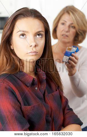 Mother Talking To Teenage Daughter About Dangers Of Smoking