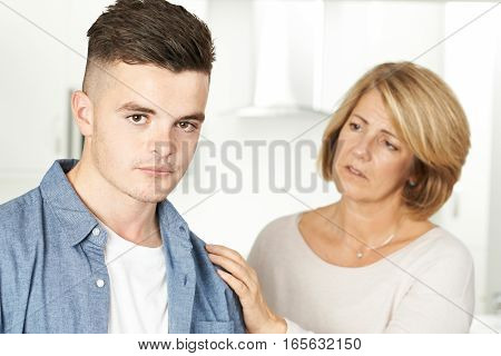 Mother Worried About Unhappy Teenage Son At Home