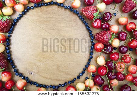 Many Fresh Fruit Lying Around The Circle Of Blueberries