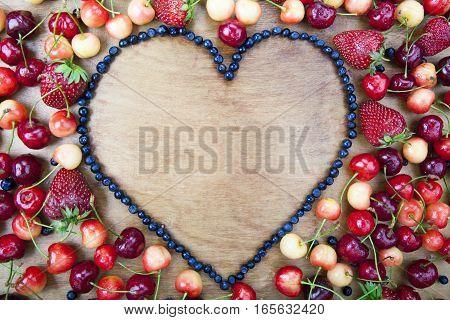 Many Fresh Fruit Lying Around The Heart Of Blueberries