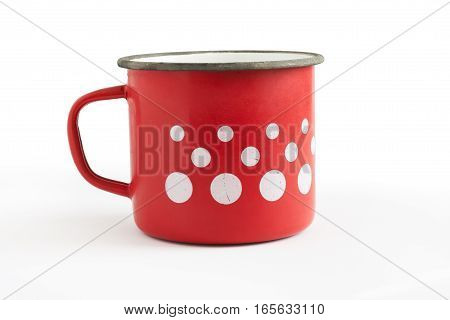 Old red enamel cup with white dots isolated on white background