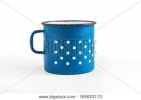 Old blue enamel cup with white dots isolated on white background