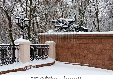Gomel Palace and Park Ensemble in winter after snowfall. Cannon on parapet in snowy park