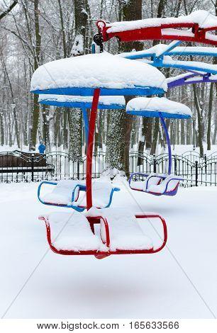 Snowy attraction in winter park during snowfall Gomel Belarus