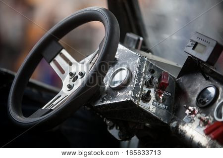 Close up shot of a dirty steering wheel