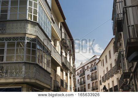 Jaen (Andalucia Spain): old street buildings with typical verandas
