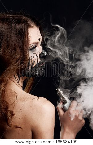 Girl With Make Up And Electronic Cigarette Making Clouds