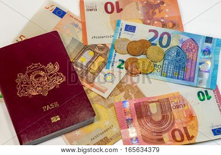 Passport and money - ready to travel anywhere on white background