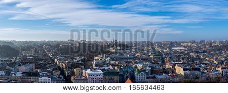 Winter panorama - landscape of old town Lvov in Ukraine with red roof