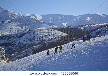 tourists on the hillside, Hiking to the snowy peaks