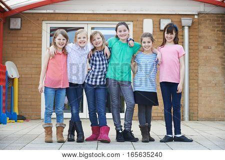 Portrait Of Female School Pupils Outside Classroom