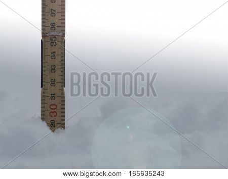 A measuring stick in the 29 cm deep snow,