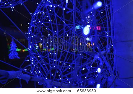 luminous garland of small blue lights reminiscent of the web