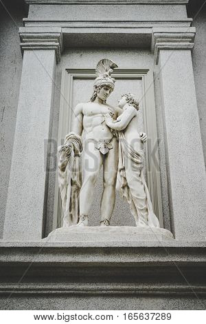white greek man and women statue with frame