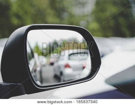 car black wing mirror with parking background