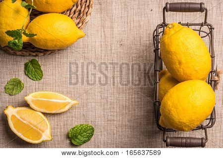 Slices, half fresh juicy lemon with mint leaves. Top view with copy space.