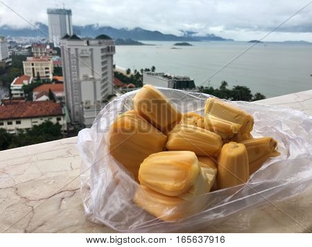 pieces of exotic fruit Jackfruit on the background of Vietnamese cities and the South China sea