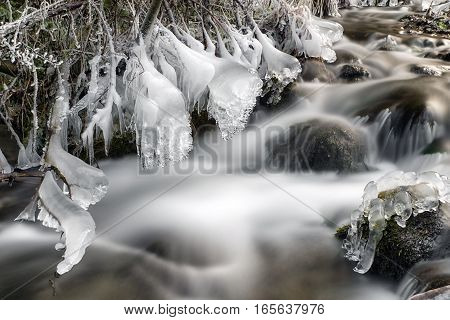 Frozen river in forest - long exposure with ND filter