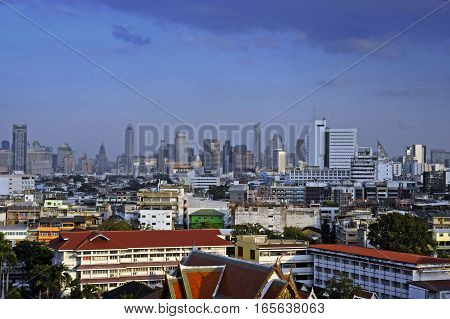 amazing Bangkok scenic urban view of skyline business district from golden mountain viewpoint under a blue sky in Thailand in tourism and holiday destination city concept