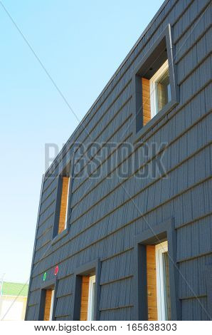 Close up on Window in New Modern Passive House Energy Efficiency Facade Wall