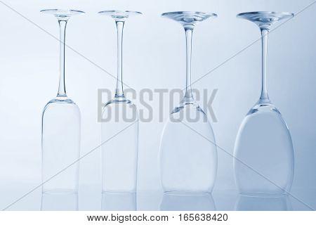 four empty wine glass on a light background