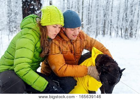 Activefamily Walk The Dog In The Winter Forest.