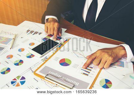 Businessman Check Business Report.
