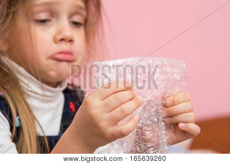 Upset Girl Pouting Cheeks Eats Bubbles Packaging Film