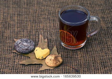 cup of tea with lemon and biscuits