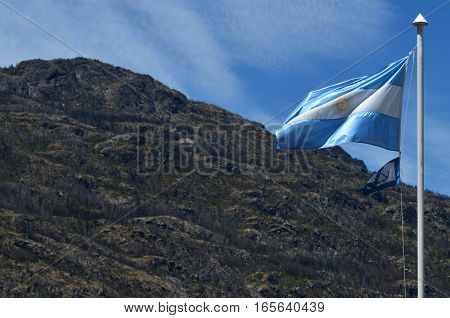 Argentinian Flag rised with Patagonian Mountain Behind