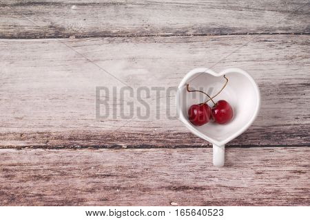 Cherries Chile And Heart-shaped Mug On Wooden.