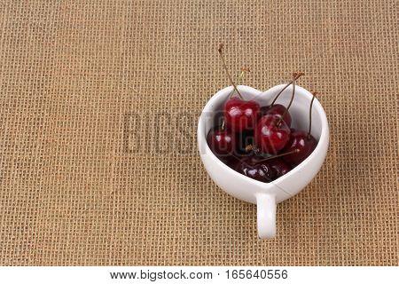 Cherries Chile And Heart-shaped Mug On Sackcloth.