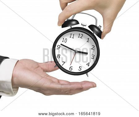 Woman Hand Giving One Alarm Clock To Man Hand