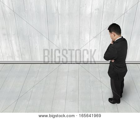 Standing Businessman Holding Hand On Chin And Thinking