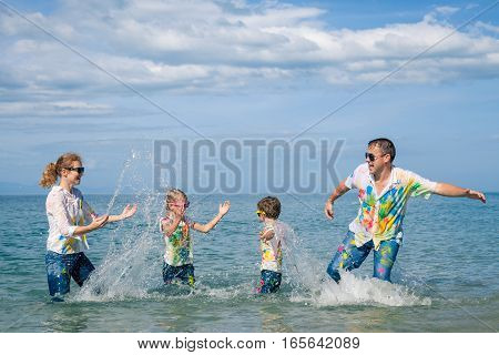 Happy Family Playing On The Beach At The Day Time.