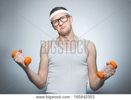 Facial Expression Nerd With Dumbbells