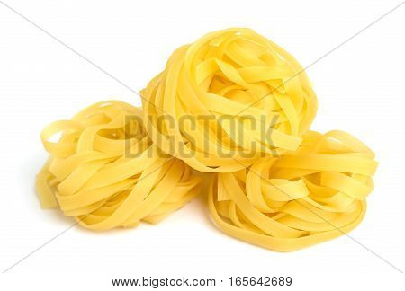 Pasta tagliatelle in a nest isolated on white background. Close-up.
