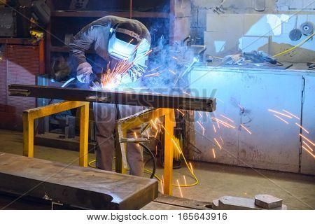 Working Welder Welds Parts Factory