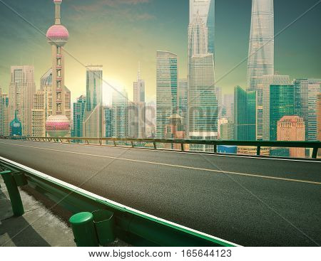 Empty road textured floor  with Aerial photography bird-eye view at Shanghai bund Skyline of sunrise