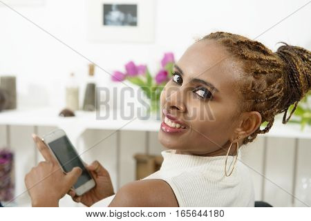 Beautiful young african american woman using mobile phone