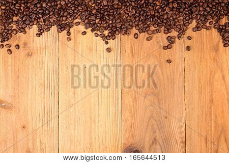 Coffee Background. Heap Roasted Coffee Beans Spread Over On Table
