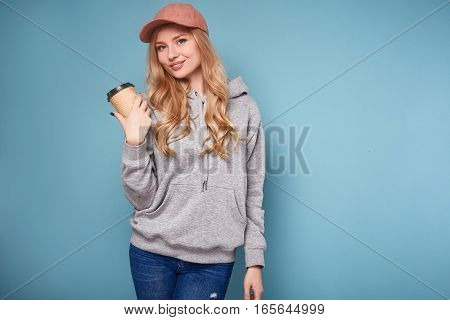 Cute Positive Blonde Woman In Pink Cap With Coffee