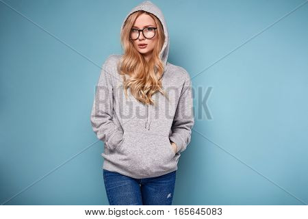 Cute Positive Blonde Woman In Gray Hoodie And Glasses
