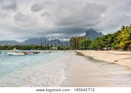 Tamarin Mauritius - December 8 2015: Tamarin bay landscape in cloudy weather with mountain in background Tamarin Mauritius.