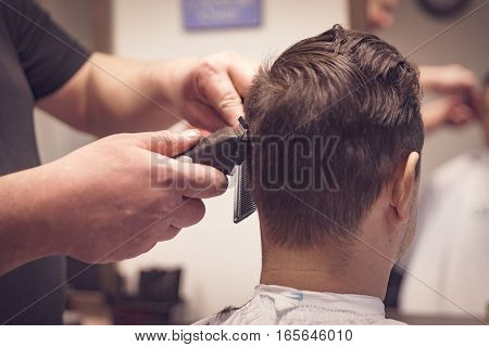 Making Haircut By Hairdresser  At Barbershop